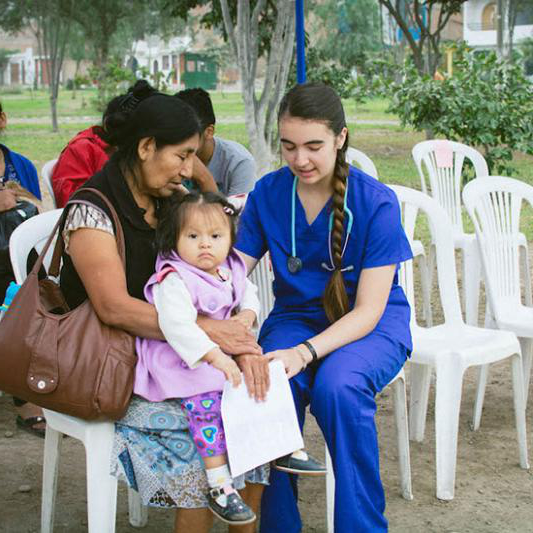 A student works on a medical mission in Peru.