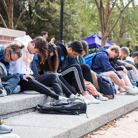 Students in a prayer vigil in Bison Square